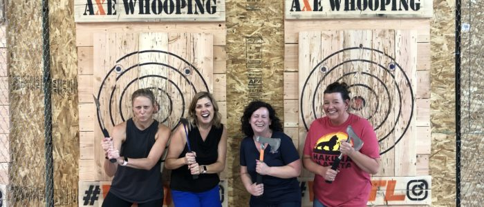 Group of women throwing Axes at Axe Whooping